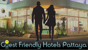 Man and woman approaching guest friendly hotel